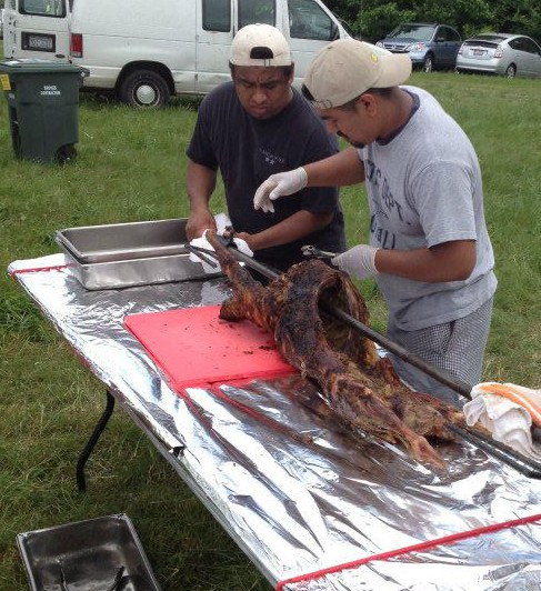 Chef Jay Pierce works with Lucky 32 cooks to spit-roast a lamb, at last year's event