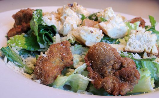 Our Wintry Salad: Reminiscent of our fried oysters caesar salad, this too features Parmigiano-Reggiano cheese in the dressing and atop the salad, and croutons made from Ciabatta bread from Orlando Bakery, in Cleveland, OH.
