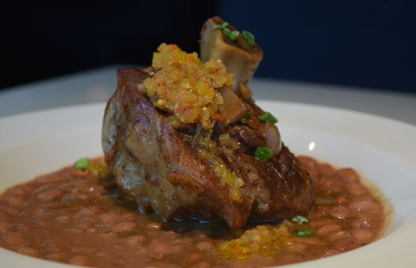 Pork Shank Braised in Red-Eye Gravy on slow-cooked pinto beans, topped with green tomato chowchow