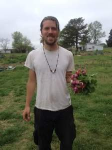 Jesse Crouch from NC Regrown, with radishes picked for Lucky 32