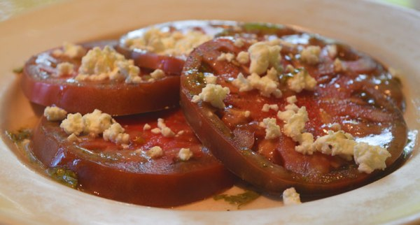 Heirloom Tomatoes with sea salt, cracked black pepper, fresh herb vinaigrette and crumbled Goat Lady chèvre